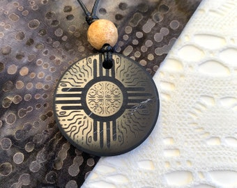 EMF Protection | Shungite Pendant | Zia Sun Symbol
