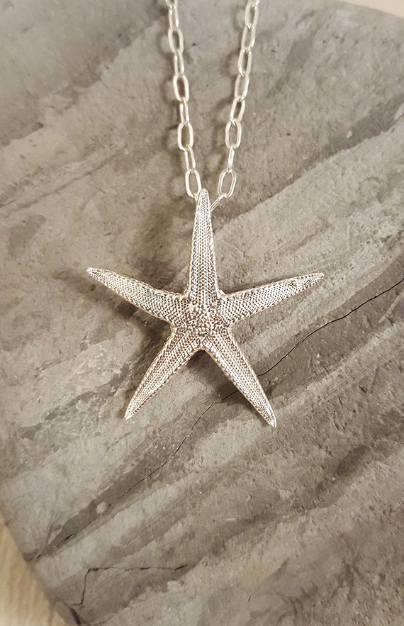 Long begging necklace glass blossom starfish