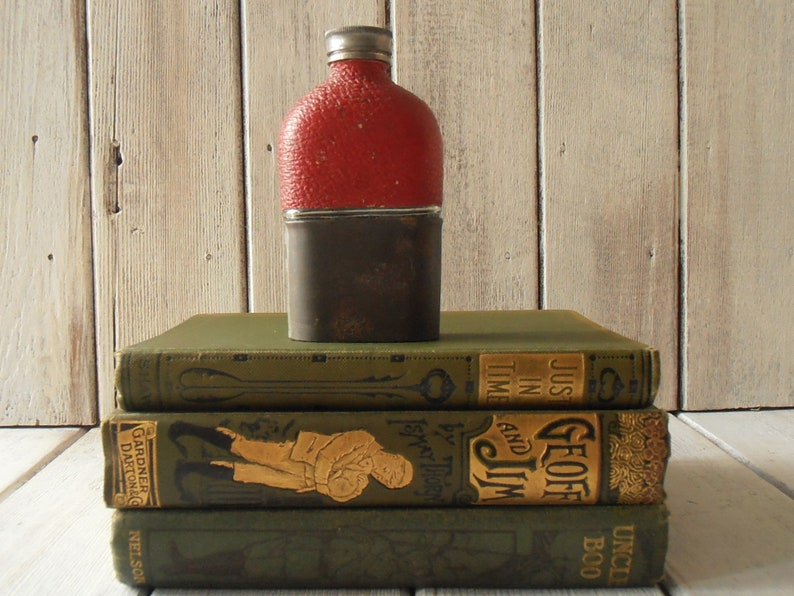 9b24c17e6a Antique WW1 era hip flask. Half red leather, half white metal cup over a  glass flask. Screw on knurled lid. Military memorabilia. Man cave