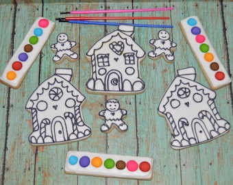 12 gingerbreed house cookies  12 mini gingerbreed man cookies 12 color palette cookies and 12 brushes