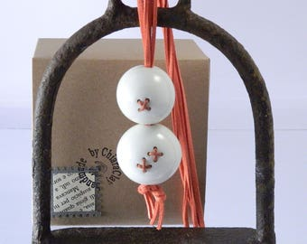 Necklace with porcelain beads sewn