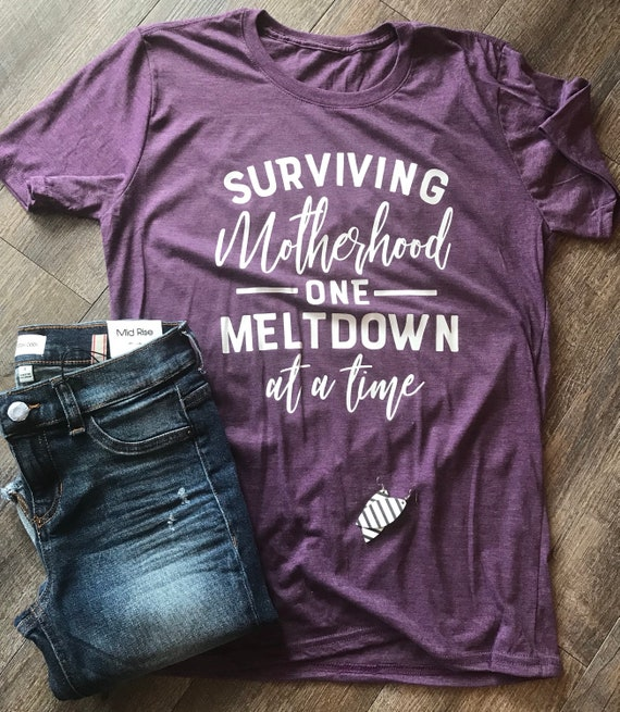 7e558f88b0 Surviving motherhood one meltdown at a time funny mom life tee | Etsy