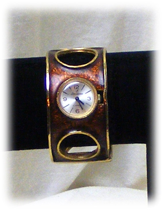 BROWN ENAMELED WATCH . . Hinged with Clasp