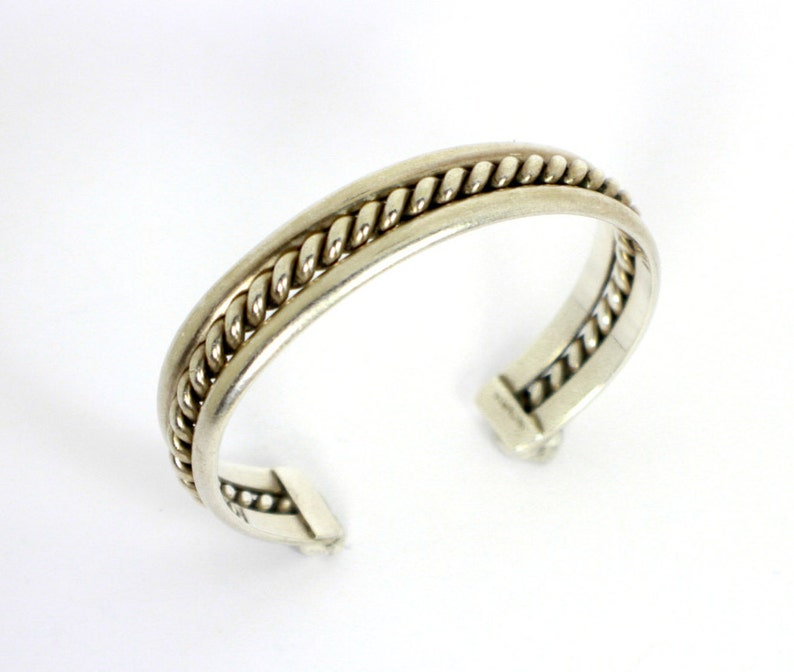 Silver cuff style Native American Bracelet with heavily braided silver rope in the center of two silver bands Sterling Silver 925 0471