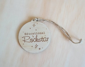 Teachers gift christmas bauble. Educational rockstar