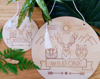 Wild Animal timber wall art. Laser etched Wild One design wall discs.