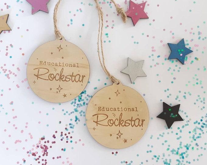 Teachers gift christmas bauble. Educational rockstar