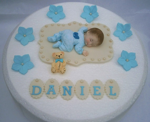 Edible baby boys Christening / 1st birthday cake topper. Boys Baptism cake decoration with blue flowers.