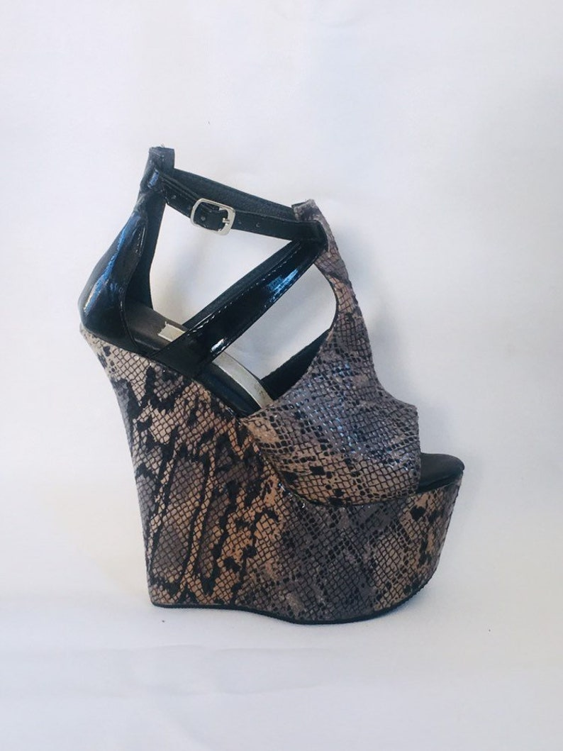 566ddb70cb4 7 inch Snake Print   Black Patent Ankle Strap High Heel Wedge