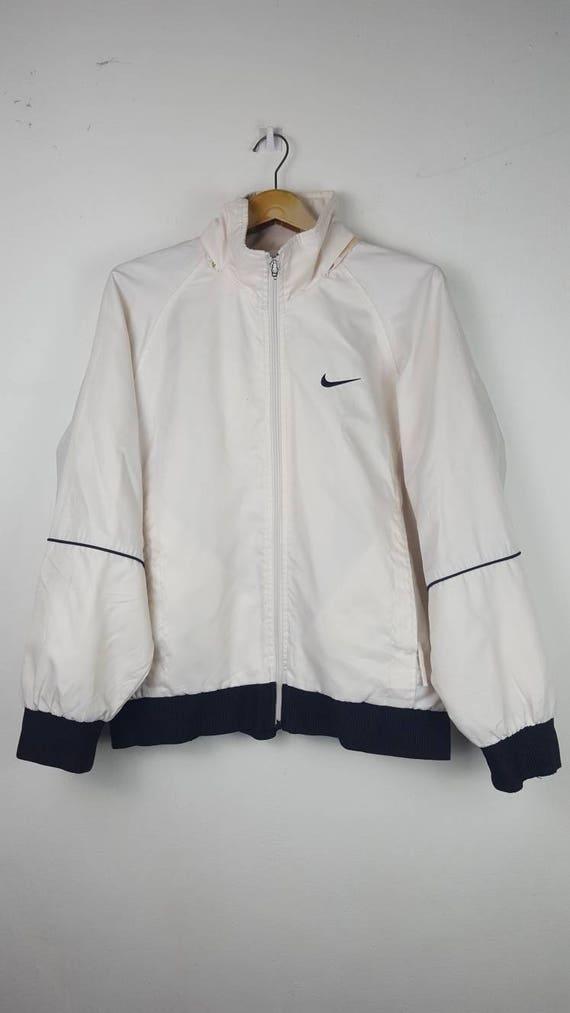 eb39f9b40240b Vintage Nike Swoosh white small logo windbreaker jacket   Etsy