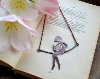 Girl reading a book, copper necklace