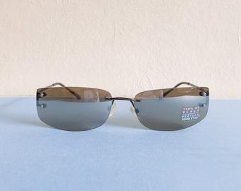 3115b90ed93 Vintage 90s y2k framles rectangular curved sunglasses