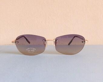 48e30a6dcc7519 Vintage jaren 1990 y2k ronde ombre frameless zonnebril