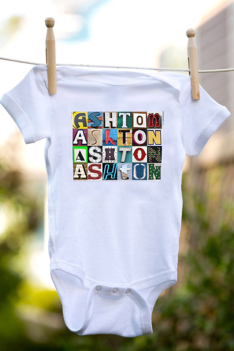 Personalized baby bodysuit featuring the name ASHTON showcased