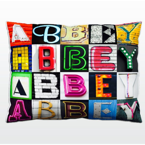 Personalized Pillow featuring ABBEY in photos of sign letters