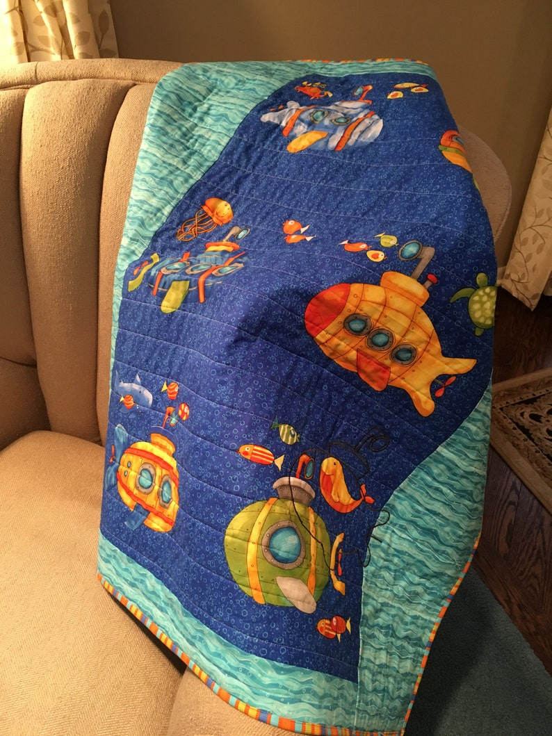 Baby Quilt with submarine appliqu\u00e9 and colorful under the sea creatures