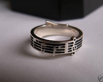 Handmade sterling silver music ring