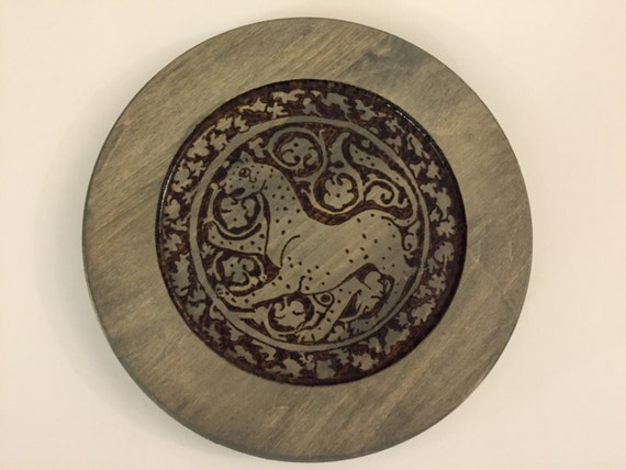 Medieval islamic lioness on plate