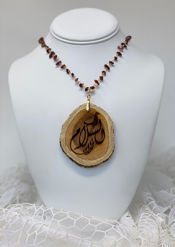"""The Arabesque® Natural Wooden Peace Pendant Engraved in Arabic Calligraphy With Garnet Nugget 24"""" 24k Gold Plated Rosary Necklace"""