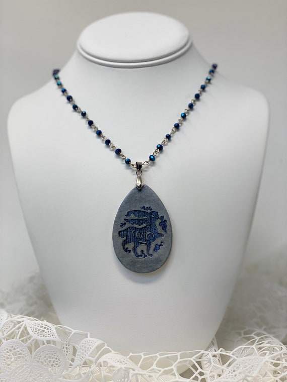 The Arabesque® Wooden Engraved Medieval Bunny Teardrop Pendant with Cobalt Blue Glass Bead and Rhodium Plated Rosary Necklace