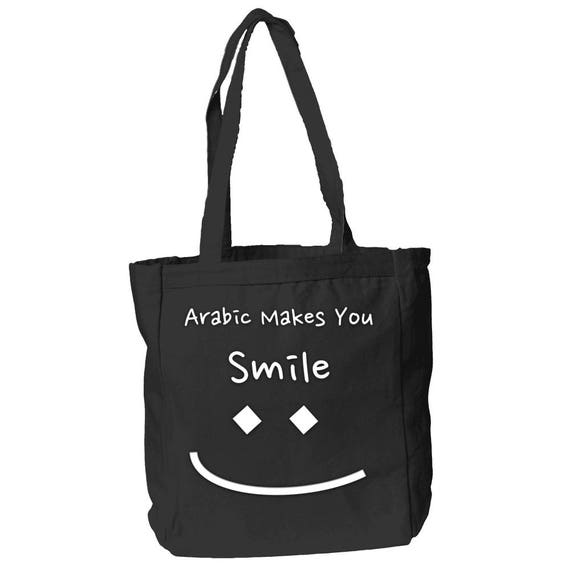 The Arabic Taa Will Make You Smile 12 oz Canvas Book Tote Bag By The Arabesque