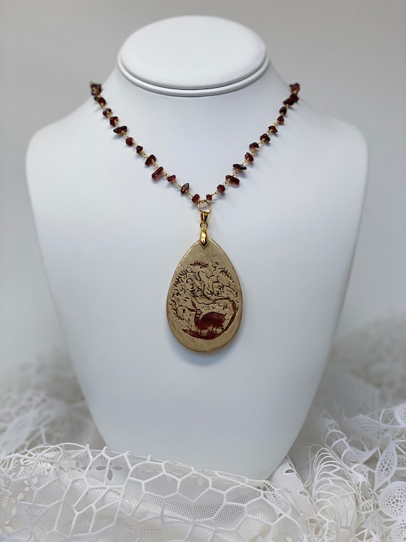 The Arabesque® Wooden Engraved 16th Century Bunny Design Teardrop Pendant with Garnet Nugget Bead 24k Gold Plated Rosary Necklace