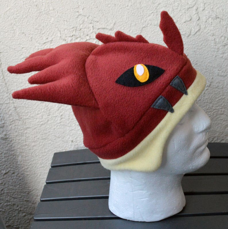 123239c2e328a Lao-Shan Lung Monster Hunter Fleece Hat with Earflaps