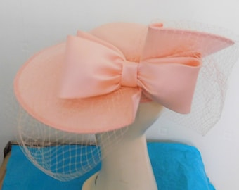 Ladies Wedding / Races Hat in Peach Split Brim with Double Satin Bow Over/under Split with Full Veil By Genevieve Louis by Nigel Rayment