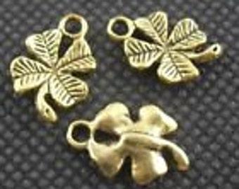 Four leaf clover brass color charm 10 charms