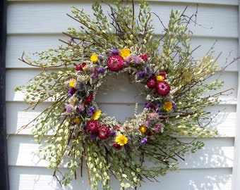 Twig wreath filled with dried herbs and flowers