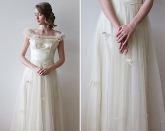7a751e98db5a Vintage 1950s Ivory Tulle Tea Length Wedding Dress with Satin Bow Details