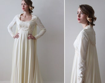 a17943a47d1f Vintage 1970s Long Sleeved Ivory Empire Waist Wedding Dress with Cape Train