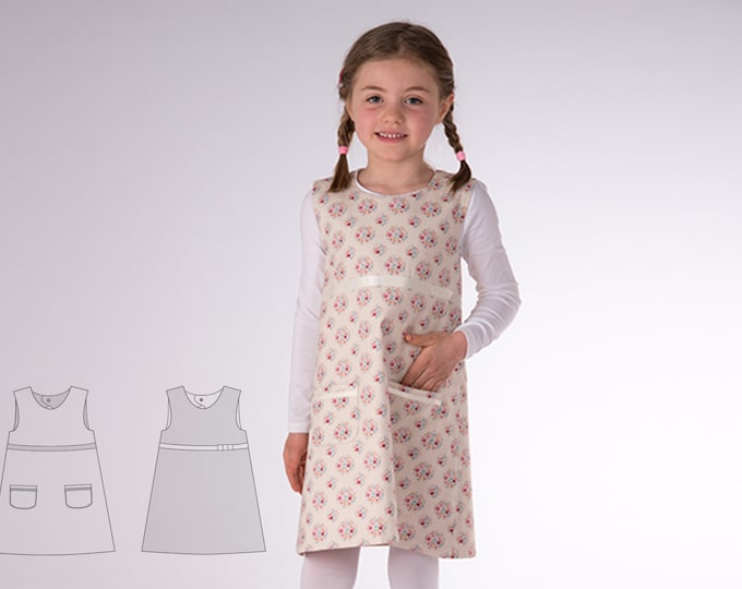 Baby girls reversible dress sewing pattern pdf with drop neckline. Tunic pinafore dress with ribbons and pockets ELENA by Patternforkids