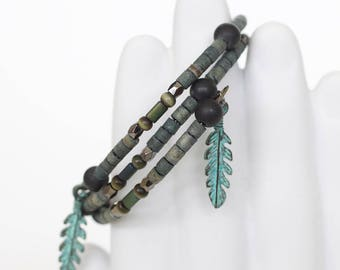 Tribal wire bracelet, beaded wrap bracelet, black, grey, green beads, feather charms, 2 loop wire wrap + charity donation