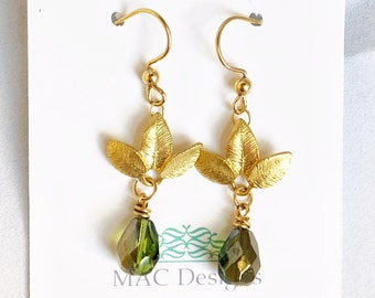 Gold leaf and green crystal drop dangle earrings.