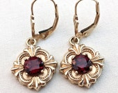 14k gold and red garnet dangle earrings for pierced ears 5.9 grams garnets .85 carats each