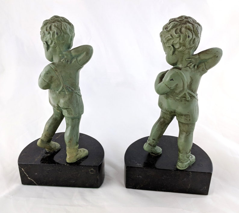 Pair of Young Boy green painted spelter on black marble bookends