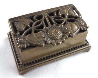 Art Nouveau style brass stamp box