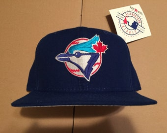 1f5b761b17a Vintage deadstock toronto blue jays 90s snapback hat cap jersey mlb nwt  raptors 80s new era logo raptors maple leafs made in usa