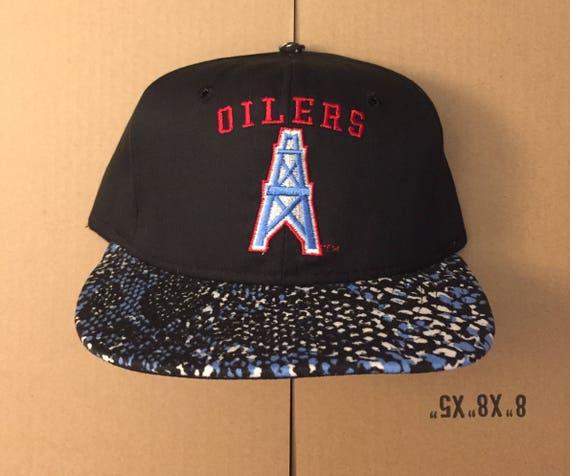 Vintage deadstock Houston Oilers snapback hat cap 90s jersey  88828e62aee6