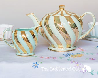 Whimsical vintage teal blue and gold Sadler teapot in a round, swirl shape, collector's teapot