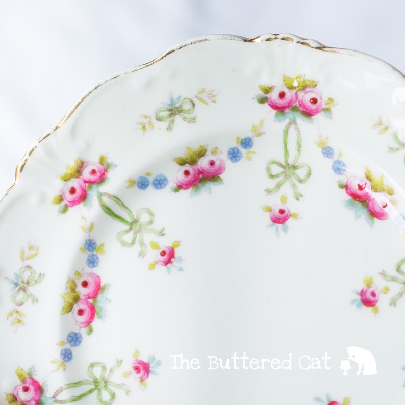 Collectible antique English china tea plate hand-decorated plate bows and rose swags