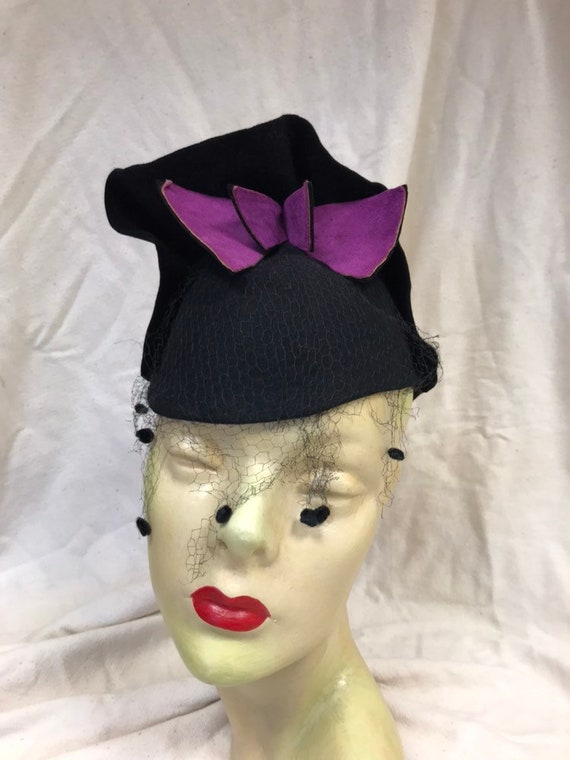 Dramatic 40s fez style hat with purple flashes