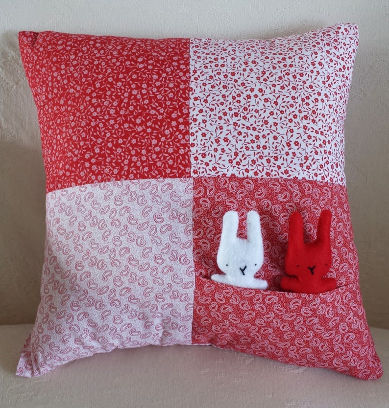 Hand-Stitched Red and White Bunnies in Pocket Child's image 0