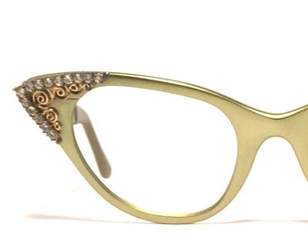 7fd9636553f Vintage eyewear. Cat eye style. Stunning rhinestones and filigree details!  Excellent quality and condition! Made by Tura 1950 s. Stunning!