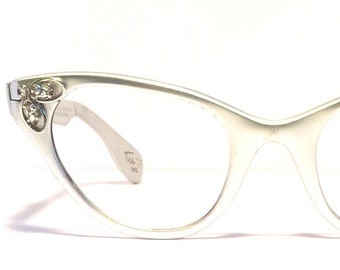 d3e2cd3a6a1 Fabulous vintage eyewear! Cat eye style. Made in USA by Tura 1950 s. Silver  aluminum. Big beautiful rhinestone! High quality! Cool specs!