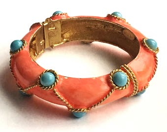 K.J.L. signed iconic Kenneth Jay Lane early clamper bracelet faux turquoise cabochons, coral enamel over gold plated bracelet. Nautical