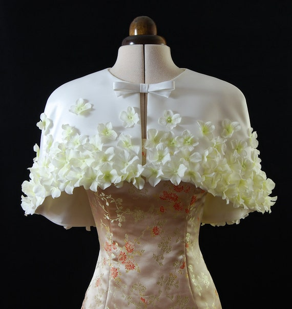 Short Cape Capelet in Ivory heavy matt  satin with sewn on artificial flowers