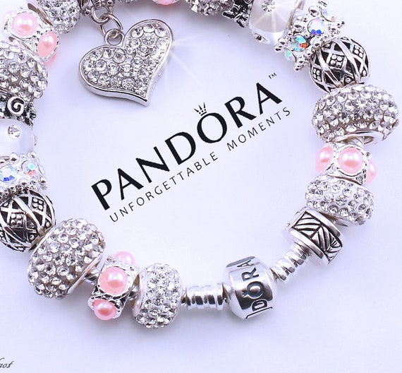 930e2e676bde Authentic PANDORA bracelet sterling silver with charms and gift box !