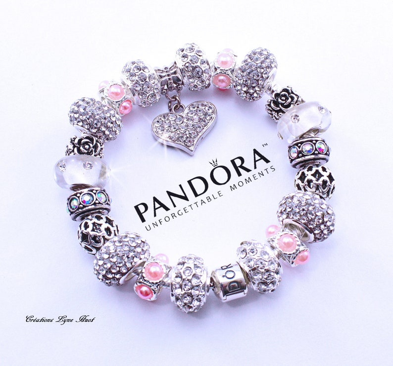 ab1a98c23 Authentic PANDORA bracelet sterling silver with charms and   Etsy